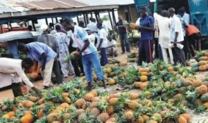 People buying pineapples at the fruit market in Bauchi, recently