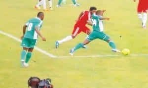 Super Eagles player trying to beat an opponent during World Cup qualifiers in Calabar, Cross River State, recently