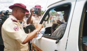 frsc Zonal Commanding Officer in-charge of Edo, Delta and Anambra States, Mr Charles Akpabio, distributing fliers to motorists during the campaign of the  2nd special intervention patrol of the frsc Zone 5 Command in Oraifite, in Ekwusigo lga, Anambra State, recently. Photo: NAN.