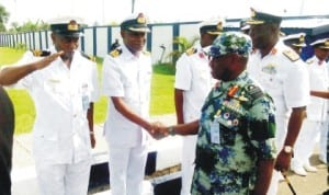 Chief of Naval Staff, Vice Adm. Usman Jibril (right), being received by naval personnel at the  headquarters of the Nigerian Navy Logistics Command in Oghara, Delta State, last Monday. Photo: NAN