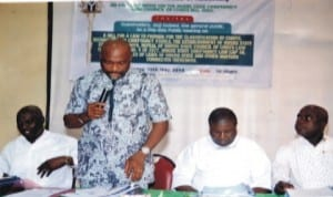 Chairman, House Committee on Chieftaincy and Conucil of Chiefs Bill 2014, Hon Chidi Lloyd (standing), making opening remark.  Other members of the committee, Hon (Dr) Sam Eligwe (right), Hon Robinson Ewor  (2nd  right), Hon Ibiso Nwuchen (left) at the public hearing of the Rivers State Chieftaincy and Conucil of Chiefs Bill in Port Harcourt. Photo: Chris Monyanaga