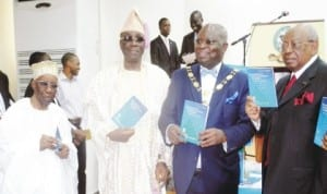 """L-R: Founder, Chartered Institute of Bankers of Nigeria, (CIBN), Alhaji Oladimeji Otiti, Oba of Lagos, Obarilwan Akiolu, President, CIBN, Dr Sina Aina and Chairman, First City Monument Bank, Otunba Micheal Balogun, during the unveiling of a Book titled """"The Economy of Financial Inclusion in Nigeria"""" written by Dr Aina in Lagos last Friday."""