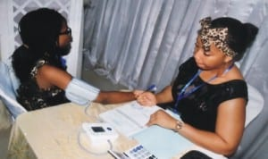 An Attendant of DibetiCare International Foundation, Chinenye Iheanachor (right), conducting a diabetic test, during the foundation's seminar in Port Harcourt, recently.