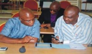 Member representing Khana Constituency I,  Hon.  Legbosi Nwidadah (left) confering with Hon. Golden Chioma, representing Etche Constituency I (right) at the sitting of the House,  last Wednesday. Photo: Chris Monyanaga.
