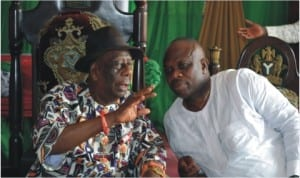 Chairman,Rivers State Council of Traditional Rulers and Gbenemene Tai, King Godwin N.K Gininwa (left), explaining a point to  President General, Ogoni Democratic Movement, Hon Godwin Bazari, during a courtesy visit to his palace, recently.