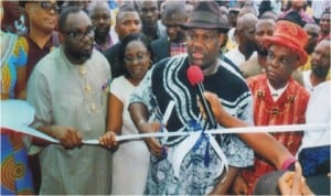 Rivers State Deputy Governor, Engr Tele Ikuru, representing Governor Amaechi cutting the tape to officially commission the Port Harcourt Local Government Council Legislative building. With him are Mayor of Port Harcourt, Chimbeko Akarolo and Eze Victor N Woluchem,  Eze Epara Rebisi XII and other dignitaries, during the commissioning, last Tuesday