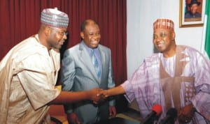 Vice President Namadi Sambo (right), in a handshake with the Minister of State for Power, Mohammed Wakil (left), during a courtesy visit by North South Power Limited Executives in Abuja last Wednesday. With them is the Minister of Power, Prof. Chinedu Nebo. Photo: NAN