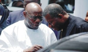 Former President Olusegun Obasanjo (left), discussing with President Goodluck Jonathan at the funeral service of former Lagos Governor, Sir Michael Otedola in Lagos last Friday. Photo: NAN