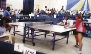 Table tennis players struggling for honours during a national event in Port Harcourt, Rivers State recently. Photo: Chris Monyanaga.
