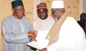 President Goodluck Jonathan (left) receiving a letter from the Khalifah Sheikh, Ahmed Tijani Inyass (right) who visited the Presidential Villa, Abuja last  Saturday.  With them is the son of the Sheikh, Ahmed-Tijani Awalu.