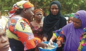 Women preparing food during a practical session on processing food for school feeding and family nourishment organised by the Federal Ministry of Agriculture in Gombe.