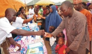 Naval medical personnel dispensing drugs to people, during the Medical Rhapsody to commemorate 58th  anniversary of Nigerian Navy at Mpape in Abuja, recently. Photo: NAN