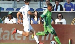 Super Eagles Striker, Emmanuel Emenike taking on a Greece defender in their friendly match early today. The encounter ended goalless