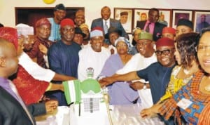 Senators cutting cake with Senate President David Mark (middle) to end the 3rd session of the 7th Senate at the National Assembly in Abuja, yesterday. Photo: NAN