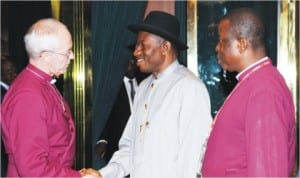 President Goodluck Jonathan (middle), welcoming the Archbishop of Canterbury, Rt. Rev. Justin Welby, during his visit to the Presidential Villa in Abuja last Wednesday. With them is the Primate of the Anglican Communion, Most Rev. Nicholas Okoh. Photo: NAN