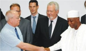 Permanent Secretary, Ministry of Works, Dr Abubakar Muhammad (right), welcoming the Chief Executive Officer, Dem Group, Mr Graham Lowe, to a Nigeria-Belgium Investment Forum in Abuja last Friday.  With them are leader of the Belgium delegation, Mr Marc Van Peel (2nd-right) and Head of Mission, Embassy of the Kingdom of Belgium, Mr Xavier Baert.