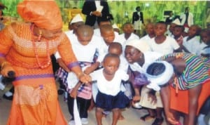 Permanent Secretary, Ministry of Commerce and Industry, and founder, Brown's Orphanage Home, Ms Kadilo Brown (left) dancing with the orphanage children during the One Year Anniversary/Thanksgiving Service at Breakthough Deliverance Ministry, Eliozu, Port Harcourt, recently. Photo: Chris Monyanaga