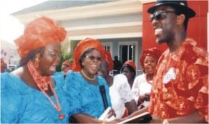 President General, Bonny Women Patriotic Movement, Amb Nne Furo Kurubo (middle), presenting an Award of Excellence to member representing Bonny Constituency in the Rivers State House of Assembly, Hon Aye Pepple. during the commissioning/handover ceremony of Bonny Women Hall in Bonny, last Saturday.  With them is Vice President, Bonny Women Patriotic Movement, Hon Lady Rosannah Igoni (left). Photo: Egberi Sampson