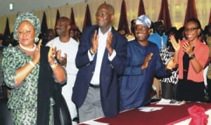 """L-R: Lagos State Commissioner for Education, Mrs Olayinka Oladunjoye, Governor Babatunde Fashola of Lagos State, Commissioner for Transportation, Mr Kayode Opeifa and Senior Special Assistant to Lagos State Governor on Transport Education, Dr Mariam Masha, at the finals of """"Be Road Friendly"""" competition in Lagos,  yesterday. Photo: NAN"""