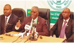 President, Nigerian Medical Association, Dr Kayode Obembe (middle), addressing a news conference on the association's demands in Abuja, yesterday. With him are 1st Vice President, Dr Titus Ibekwe (left) and Secretary, Dr Aderemi Alayaki.