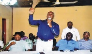 Rivers State Commissioner for Commerce and Industry, Barrister Chinye Chuma (standing), making a speech, during a congress of Non-Indigenes Political Forum in APC, Rivers State chapter in Port Harcourt  last  Wednesday.  With him are  State Co-ordinator of the forum, Chief  Uchenna  Okokoba (2nd right) and Chief  Williams Ubaka (left).