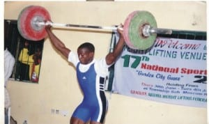 A weightlifter showing off his talent in past meeting.