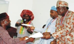 L-R: Antiquities Vendor, Mr Umaru Yusuf, Director of Museum, National Commission for Museums and Monuments (NCMM), Ms Rosemary Bodam, Director-General, NCMM, Mr Abdallah Usman and Minister of Culture, Tourism and National Orientation, Chief Edem Duke, at the presentation of payment advice to antiquities vendors in Abuja last Friday