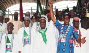Governor Aliyu Wamakko of Sokoto State (middle), raising the hand of the newly elected National Chairman of APC, Chief John Odigie-Oyegun, at the party's national convention in Abuja last Saturday . With them are former Governor of Lagos State, Bola Tinubu (left); former Head of State Gen. Muhammadu Buhari (2nd-left) and former Vice President Atiku Abubakar.