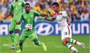 Super Eagles' Ogenyi  Onazi (17) in contest with an Iranian opponent in Curitiba, Brazil last Monday