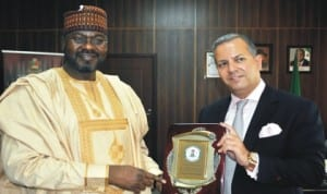 Minister of State for Power, Mr Mohammed Wakil (left), with the Leader of Investors from the United States, Mr Ron Yefeez, during their visit to the Minister in Abuja, last Monday. Photo:NAN
