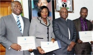 L-R: Chief of Staff to the Managing Director, Federal Airports Authority of Nigeria (FAAN), Mr Kabir Mohammed, Mrs Vivian Menyanga of the Training Department and Mr Emmanuel Chidera, Airport Operations Department, who were presented certificates by the Managing Director, FAAN, Mr Saleh Dunoma (2nd right), for having graduated in Airport Management Professional Accreditation Programme which certifies them as Airport Managers.
