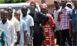 APC governorship candidate, Governor Kayode Fayemi (5th left), and his wife Bisi on queue waiting for their turn to vote at Unit 9, Ward 13 in Isan,during the governorship election in Ekiti State, last Saturday.