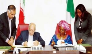 Iranian Minister of Industry, Mines and Trade/Head of Iranian Delegation, Mr Mohammad Nemaizadeh (left) and Minister of State (left) for Foreign Affairs, Prof. Viola Onwuliri, signing Memorandum of Understanding on Tourism, Geology, Mining, Mineral Processing and Industrial Cooperation at the 5th Nigeria-Iran Joint Commission meeting in Abuja last Thursday. Photo: NAN