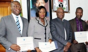 L-R: Chief of Staff to the Managing Director, Federal Airports Authority of  Nigeria (FAAN), Mr Kabir Mohammed, Mrs Vivian Menyanga of the Training Department and Mr Emmanuel Chidera, Airport Operations Department, who were presented certificates by the Managing Director, FAAN, Mr Saleh Dunoma (2nd right), having graduated in Airport Management Professional Accreditation Programme which certifies them as airport managers.