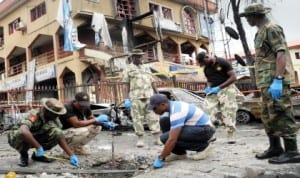 Bomb experts measuring the crater of the bomb blast at a shopping mall on Aminu Kano State Crescent, Wuse 2 in Abuja recently.