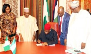 President Goodluck Jonathan (middle) signing the 2014 Pension Reform Bill into Law at the State House in Abuja last Tuesday. With him are Vice President Namadi Sambo (2nd left), Director-General, National Pension Commission, Ms Chinelo Anohu-Amazu (left), Minister Of Justice, Mohammed Adoke (2nd right) and PDP National Chairman, Alhaji Adamu Mu'azu.