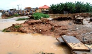 Part of  Amakeshift Bridge at Apete in Ibadan where ten people were suspected to have drowned when the bridge collapsed after a downpour recently.