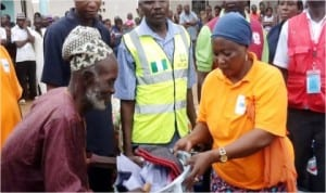 Operations Officer, NEMA Operations Office Gombe, Hajiya Zainab Umar (right), presenting relief materials to an internally displaced person in a camp in Bali, Taraba State, last Saturday.