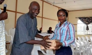 Mr Hawkins Ide,  Ag. Director, Administration, Ministry of Information and Communications, presenting a souvenir to Miss Judith  Amadi of Holy Rosary College at the 2014 Ana/Yusuf Ali Annual Schools Literary Awareness Campaign in Port Harcourt, recently. Photo: Ibioye Diama