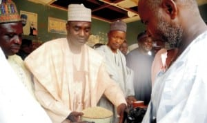 Acting Chairman of Matazu Local Government, Alhaji Mouktar Aminu-Bakori (2nd-left), inaugurating the distribution of bags of grains as Ramadan assistance to the people of the area in Katsina State last Monday. Photo: NAN