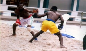 Traditional boxers in action during a national event in Port Harcourt, Rivers State recently