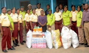 Officials of Lagos State Traffic Management Authority (LASTMA) and Kick Against Indiscipline (KAI), presenting gift items as part of their community outreach programme in Lagos last Wednesday