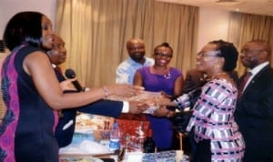 Charter President, Rotary Club of Airfield, Rotarian Nma Onuigbo (left), presenting a souvenir to the wife of Rotarian Innocent Iyalla Harry (2nd right), during Rotary Club of Airfield Charter Certificates presentation ceremony at Novotel Hotel, Port Harcourt recently. Photo: Chris Monyanaga