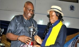 Euphoria Michael (right) receiving a trophy at Dowen College, Lagos for emerging the best graduating student 2014 at Dowen College, Lagos from Mr. Godwin Poi, GM Human Capital Development, RSSDA.