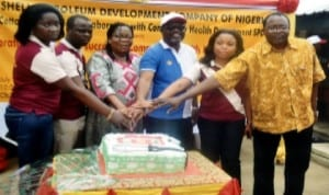 L-R: Shell Petroleum Development Company Research Adviser on Community Health Department, Dr Atom Udo, Chief Medical Director, Obio Cottage Hospital, Dr Umejiego Chidozie, Dr Alasia Osuoabo of  Rivers State Health Management Board, SPDC Regional Community Health Management Leader, Mr Edet Edet, SPDC spokes person, Mrs Gladys Afam-Anadu and SPDC Public Health Adviser to Industrial Hygiene,  Dr Akin Fajola, jointly cutting the 4th Anniversary cake during a Community Health Insurance Scheme in Port Harcourt last Saturday. Photo: Nwiueh Donatus Ken