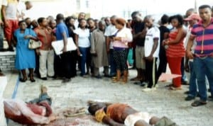 Sympathisers viewing the lifeless bodies of armed robbers  at the premises of The Tide newspapers, Port Harcourt last Monday