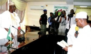 Newly appointed Secretary to Adamawa State Government, Prof. Liman Tukur (right), taking oath of office before the Acting Governor, Alhaji Ahmadu Umaru in Yola, last Wednesday.