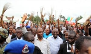 Rivers State Governor Rt. Hon. Chibuike Rotimi Amaechi being cheered by a crowd of supporters during his 'meet the people' tour of Isiokpo Community in Ikwerre Local Government Area of the state, yesterday.