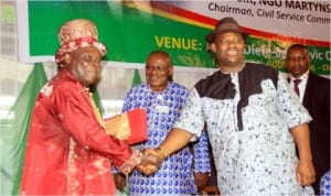 R-L Rivers State Dep Governor, EngrTele Ikuru, in a handshake with former Perm Sec,Chief Gogo Isong, while the Head of Service, Samuel Long-John, watches at the 2014 Rivers State Civil Service Day in Port Harcourt, last Monmday