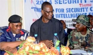 From Left: Commandant, Nigeria Security and Civil Defence Corps (Nscdc) Enugu State, Mr Nathaniel Ubong, representative of Enugu State Government, Mr Chime Richard and representative of Commandant,  Nigerian Army 82 Garrison, Capt. Umar Garba, at the Nscdc 2014 Security Summit in Enugu last Friday. Photo: NAN